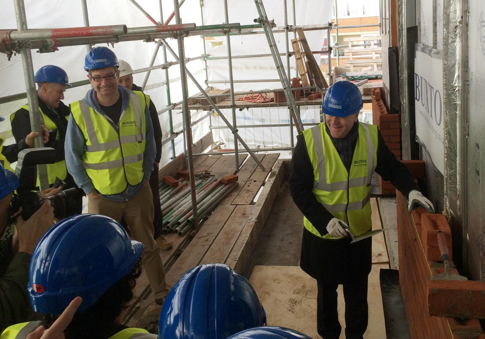 Cllr Peter John celebrates topping out of Marklake Court